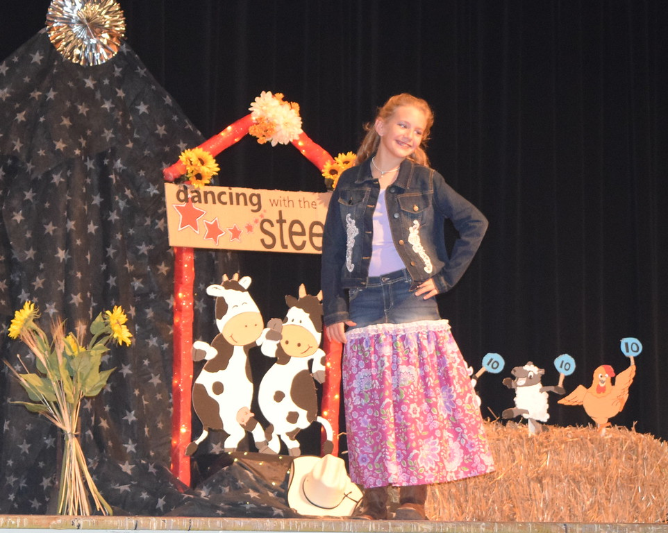 Ashton Nichols models her outfit in the junior division of the Logan County Fair 4-H Fashion Revue Friday, Aug. 4, 2017.