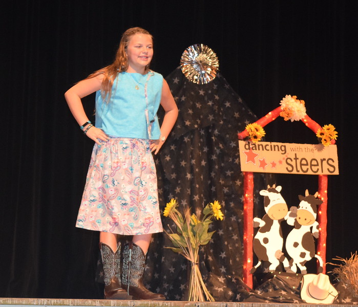 Mattea Pelton models her outfit in the junior division of the Logan County Fair 4-H Fashion Revue Friday, Aug. 4, 2017.
