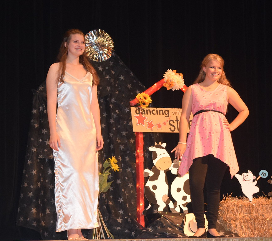 Intermediate division participants Kathryn Lock, left, and Kayleigh Mackintosh pose for a photo at the Logan County Fair 4-H Fashion Revue Friday, Aug. 4, 2017.