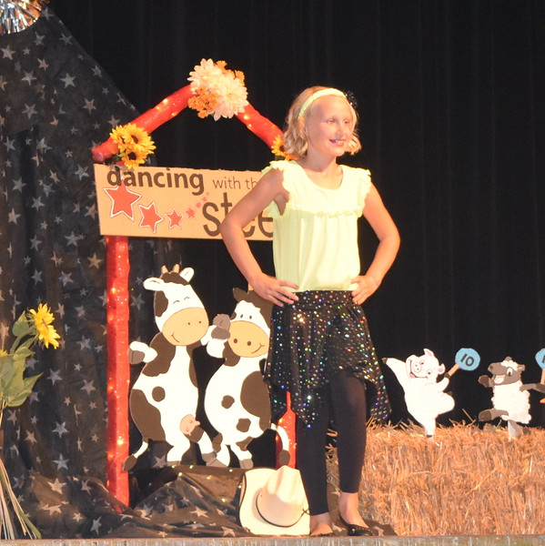 Natalie Adels models her outfit in the junior division of the Logan County Fair 4-H Fashion Revue Friday, Aug. 4, 2017.