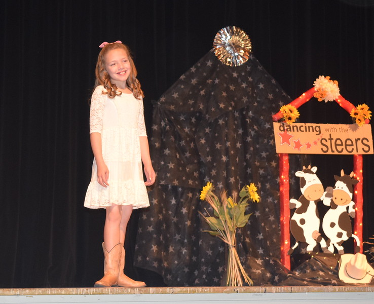 Ayla Baney models her outfit in the encore division of the Logan County Fair 4-H Fashion Revue Friday, Aug. 4, 2017.
