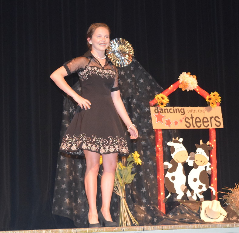 Aly Young models her outfit in the senior division of the Logan County Fair 4-H Fashion Revue Friday, Aug. 4, 2017.