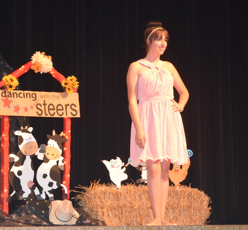 Shelby Houser models her outfit in the senior division of the Logan County Fair 4-H Fashion Revue Friday, Aug. 4, 2017.