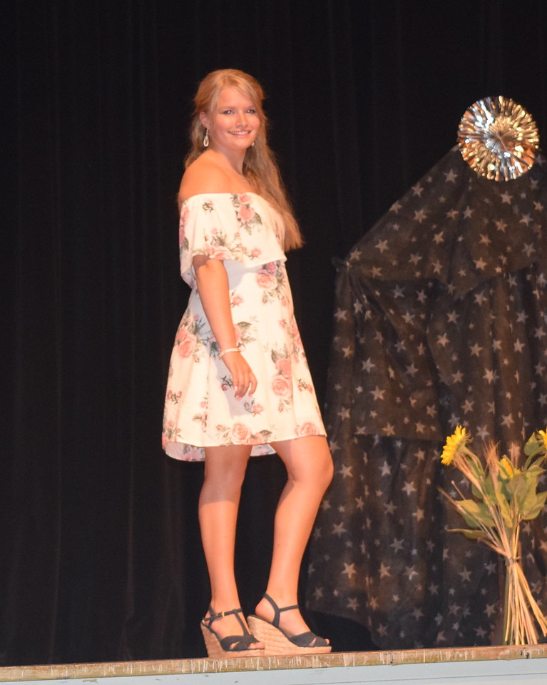 Kayleigh Mackintosh models her outfit in the encore division of the Logan County Fair 4-H Fashion Revue Friday, Aug. 4, 2017.