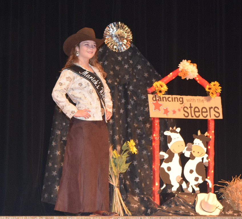 2017 Queen Contestant Morgan Duncan models her outfit at the Logan County Fair 4-H Fashion Revue Friday, Aug. 4, 2017.