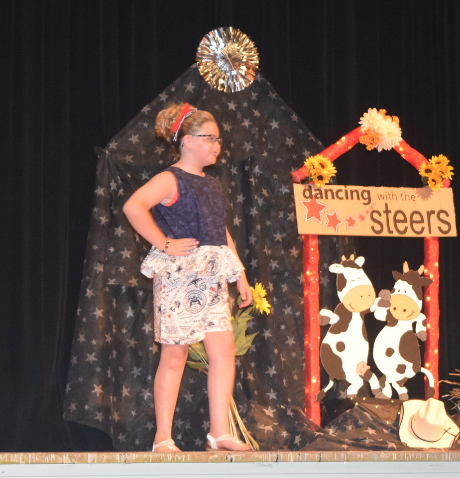 Savannah Taylor models her outfit in the junior division of the Logan County Fair 4-H Fashion Revue Friday, Aug. 4, 2017.