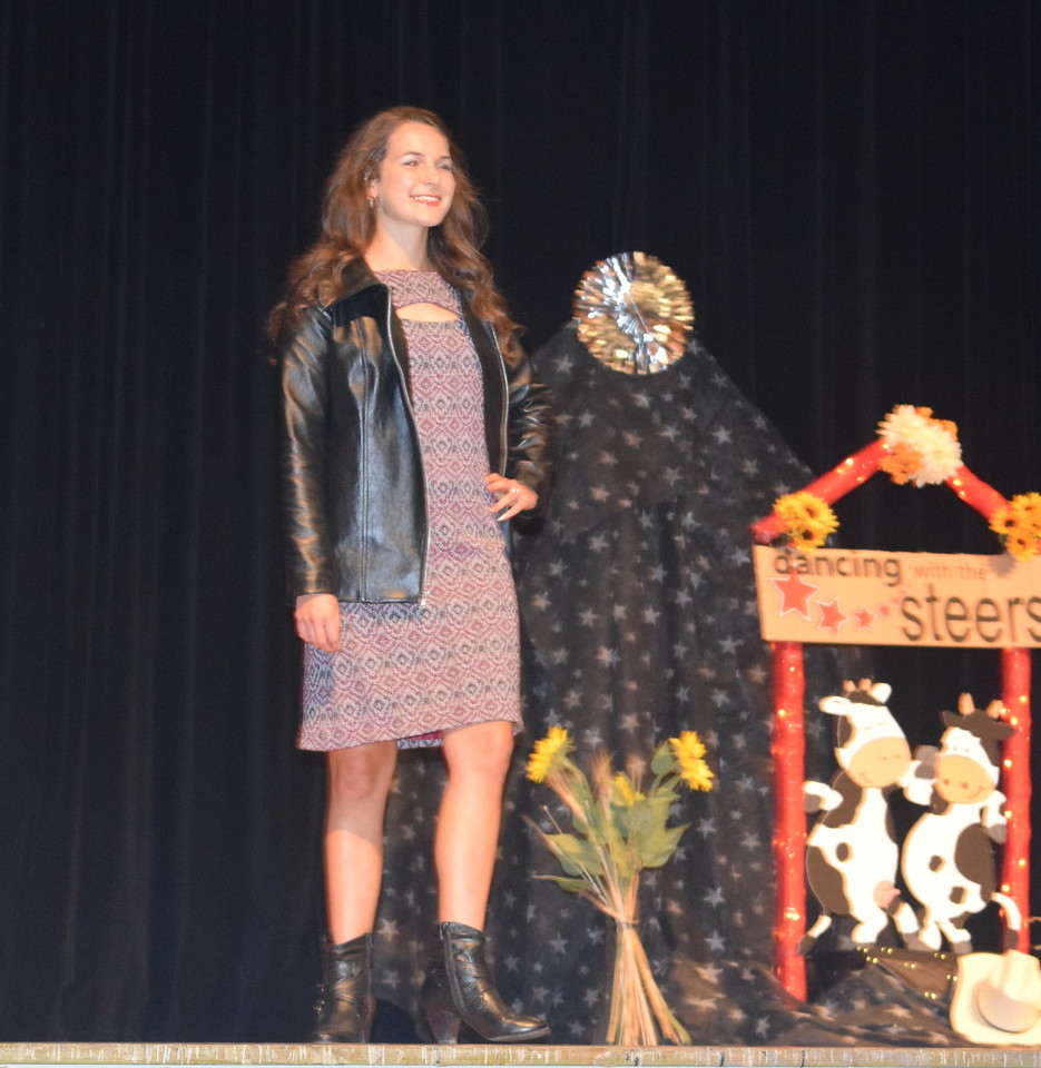 Rachael Northup models her outfit in the senior division of the Logan County Fair 4-H Fashion Revue Friday, Aug. 4, 2017.