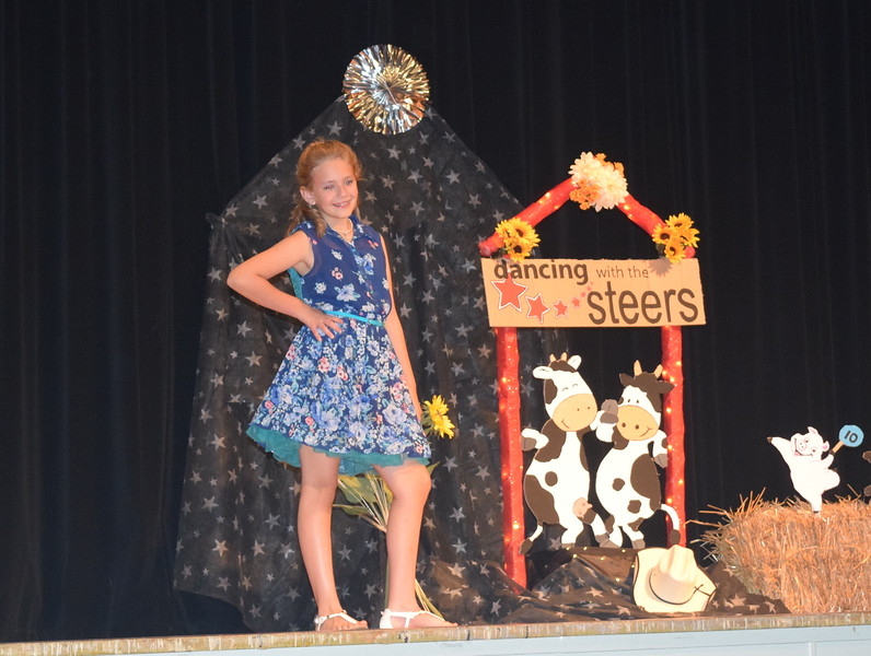 Ashton Nichols models her outfit in the encore division of the Logan County Fair 4-H Fashion Revue Friday, Aug. 4, 2017.