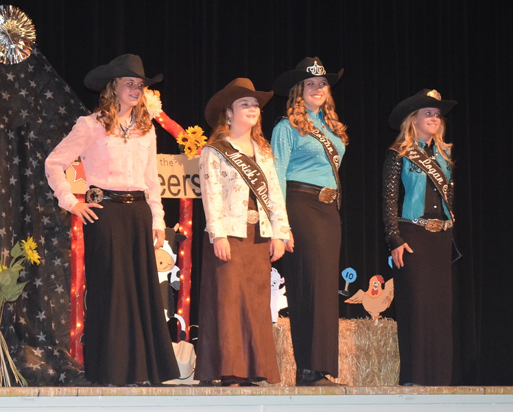 Fair Royalty model their outfits at the Logan County Fair 4-H Fashion Revue Friday, Aug. 4, 2017. From left; Logan County Sweetheart Contestant Brooke Gary, 2017 Queen Contestant Morgan Duncan, 2017 Miss Rodeo Logan County Attendant Jessica Sigmon and 2017 Miss Rodeo Logan County McKaylin Schreiner.
