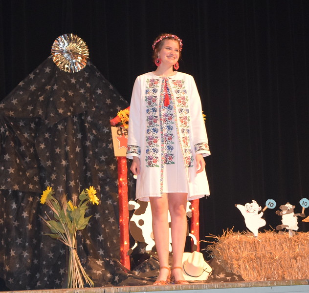 Kathryn Lock models a Ukranian outfit in the encore division of the Logan County Fair 4-H Fashion Revue Friday, Aug. 4, 2017.