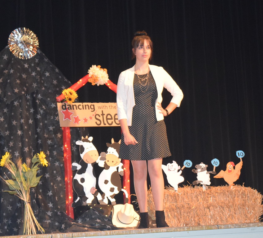 Shelby Houser models her outfit in the encore division of the Logan County Fair 4-H Fashion Revue Friday, Aug. 4, 2017.