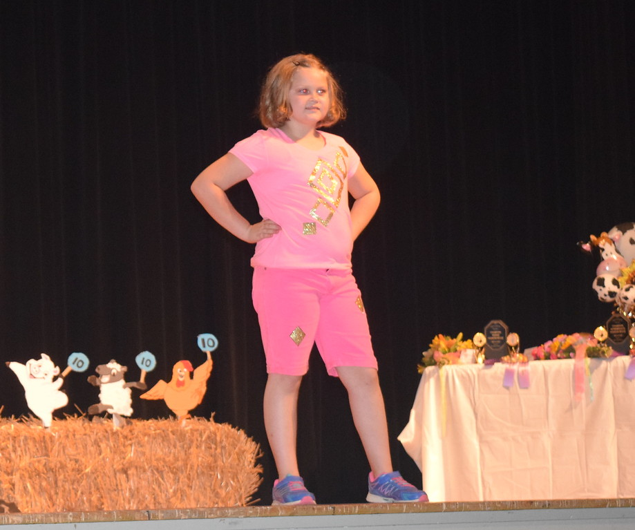 Ava Knight models her outfit in the junior division of the Logan County Fair 4-H Fashion Revue Friday, Aug. 4, 2017.
