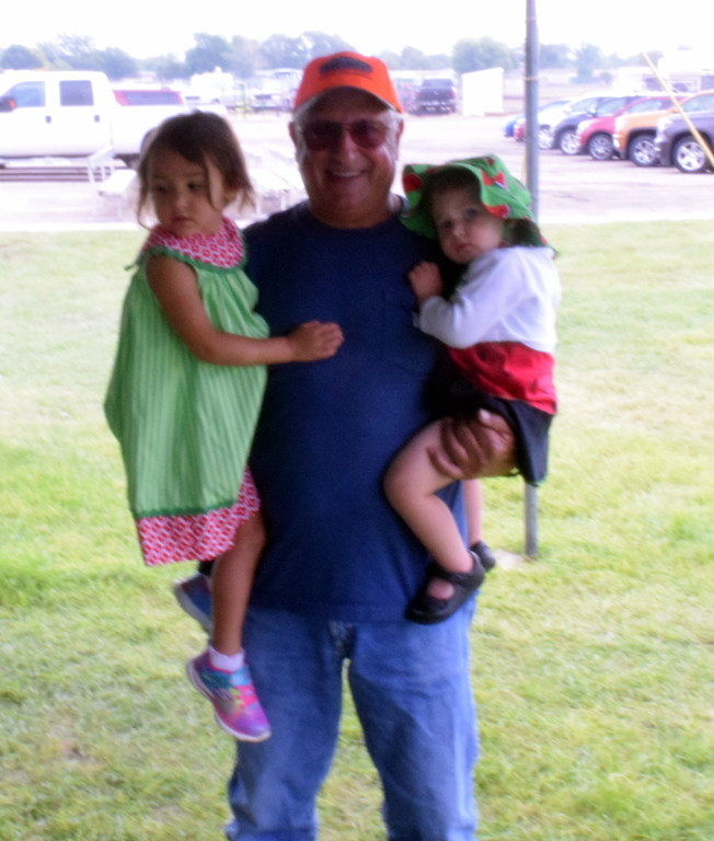 . John Korrey pictured with Kate Tribett and Ella Barnes at the Korrey Family Watermelon Feed at the Logan Country Fair on Saturday.