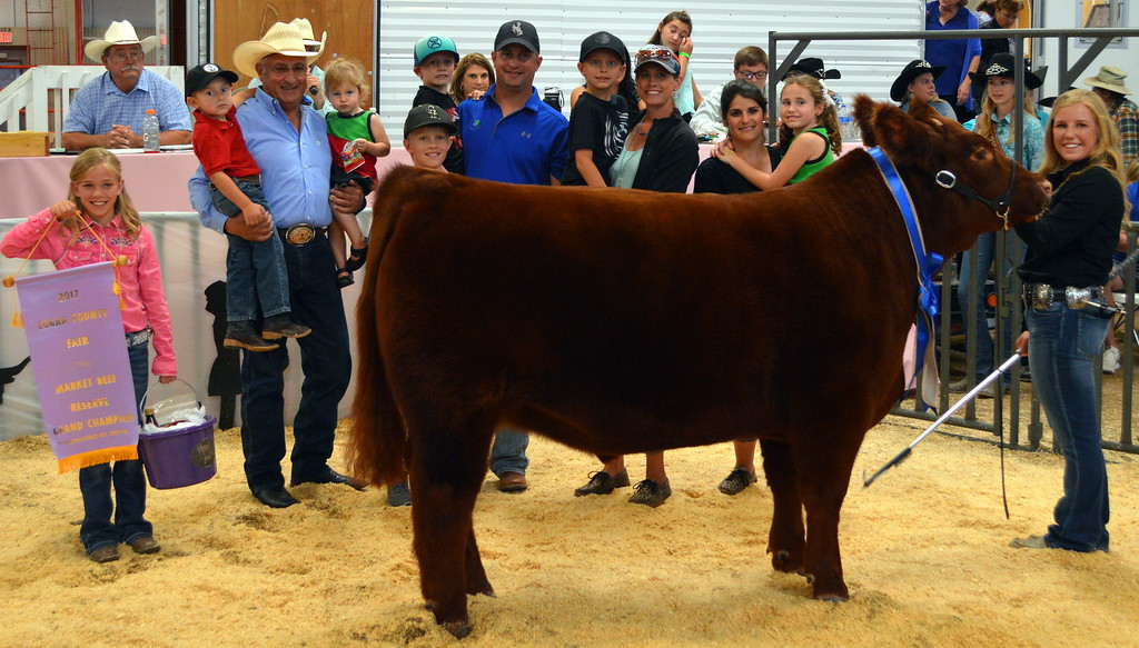 . Kinlie Lewis, Reserve Grand Champion Market Beef, purchased by Inco Digestive & Mike\'s Meat Market.