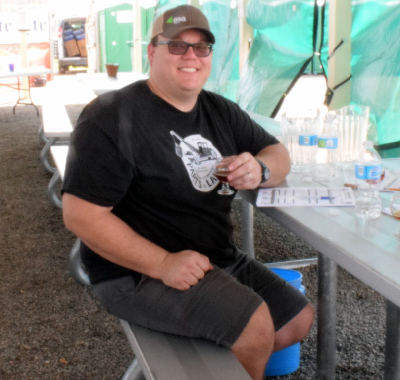 . Dylan Harford (pictured) was one of the judges at the home brew judging in the beer garden on Saturday at the Logan County Fair.  Dustin Lynd won the hoppy categry with a Red IPA which also won judges choice.  Bruce Bosley won the crisp/wheat/fruity/spicy category with a Raspberry Ale.