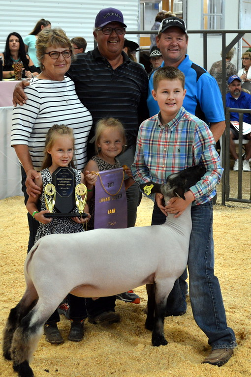 . Jaxson Samber, Reserve Grand Champion Market Sheep, purchased by Dewey\'s Bar & Grill, Henry\'s Pub & Club, Pioneer Distributing, Jackson Insurance, Smart Parts, Bank of Colorado.
