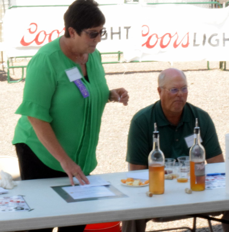 . Sharon Kauffman speaks on different factors to consider when judgine win at the hobby wine judging at the Logan County Fair on Saturday.  The contest featured dry, semi sweet, dessert, and novelty class wines.