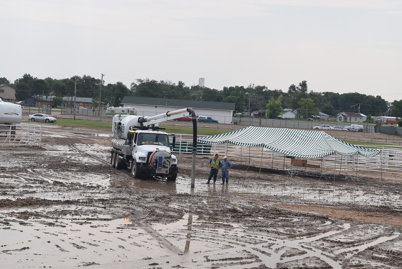 Crews were busy Wednesday, Aug. 9, 2017, working to try to dry out the grandstand arena after a rainstorm Tuesday flooded the arena. Due to the flooding the Junior Rodeo scheduled for Wednesday evening was rescheduled for Sunday, starting at 1 p.m., in the indoor arena. Parking for trailers will be on the north side of the indoor arena. Contact Rod Talbert or Kassie Roth with any questions or concerns.