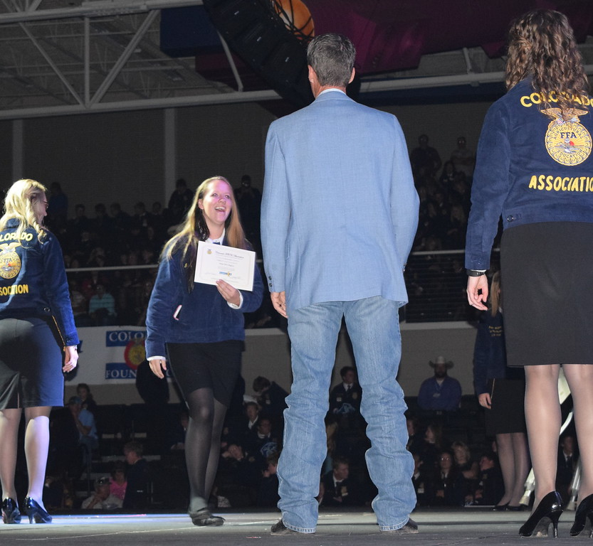 Marissa Ritter, of the Caliche FFA chapter, makes her way across the state to her her adviser Todd Thomas after receiving her State FFA Degree at the Colorado FFA State Convention Wednesday, June 8, 2016. Ritter was also recognized as a state proficiency winner in agricultural mechanics repair and maintenance placement for her Supervised Agricultural Experience (SAE).