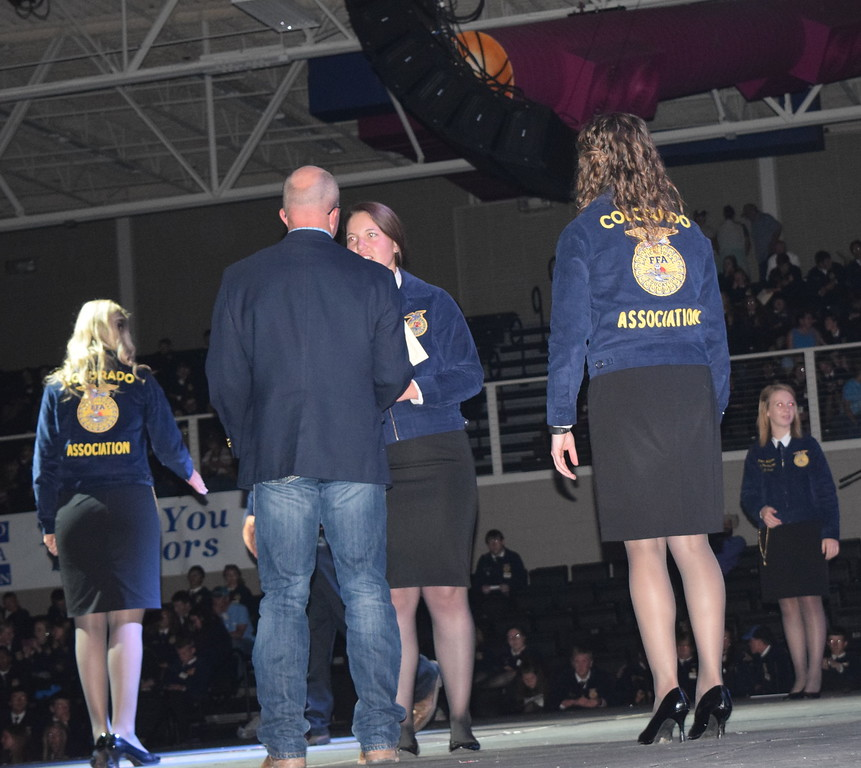 Tyra Foreman, of the Peetz FFA chapter, is congratulated by her adviser Mike Forster after receiving her State FFA Degree at the Colorado FFA State Convention Wednesday, June 8, 2016.