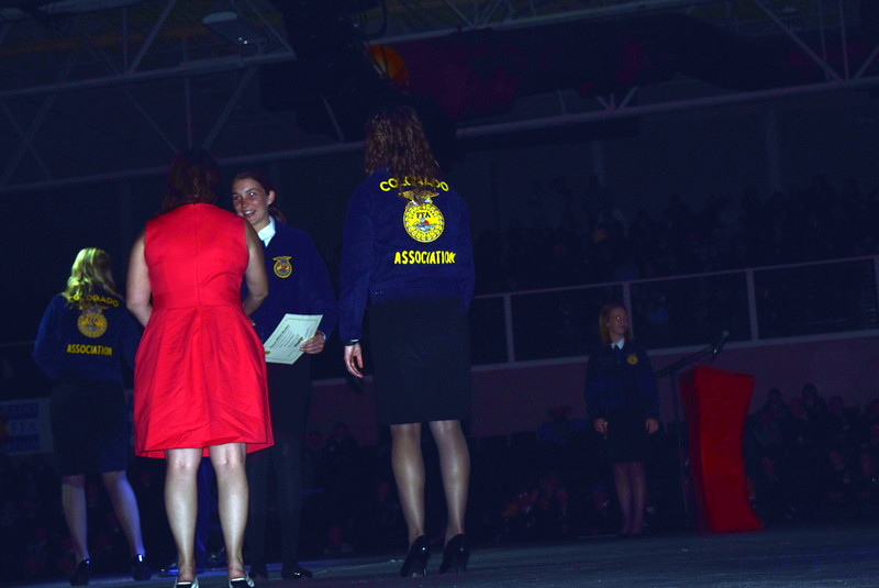 Abbey Brower, of the Sterling FFA chapter, is congratulated by her adviser Kassandra Kinney after receiving her State FFA Degree at the Colorado FFA State Convention Wednesday, June 8, 2016.