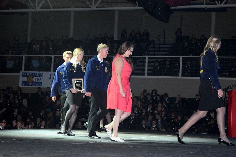 Sterling FFA chapter's state winning ag sales team and adviser Kassandra Kinney make their way off the stage after being recognized at the Colorado FFA State Convention Wednesday, June 8, 2016.