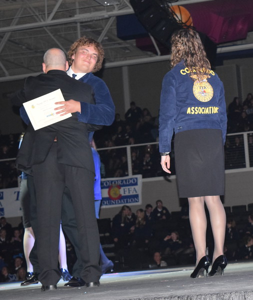 Will Mertens, of the Merino FFA chapter, gives his adviser Todd Everhardt a hug after receiving his State FFA Degree during the Colorado FFA State Convention Wednesday, June 8, 2016. He was also recognized as state proficiency winner in grain production placement for his Supervised Agricultural Experience (SAE).