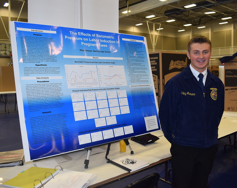 Riley Meisner, a member of the Sterling FFA chapter, poses for a photo with his agriscience fair project at the Colorado FFA State Convention Wednesday, June 8, 2016. He was the state winner in the animal sciences division II category.