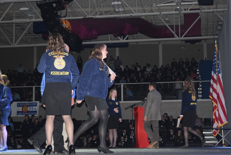 Baylee Nelson, of the Merino FFA chapter, walks off the stage after receiving her State FFA Degree at the Colorado FFA State Convention Wednesday, June 8, 2016.
