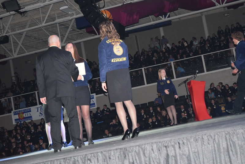 Micaela Ladd, of the Merino FFA chapter, is congratulated by her adviser Todd Everhardt after receiving her State FFA Degree at the Colorado FFA State Convention Wednesday, June 8, 2016.