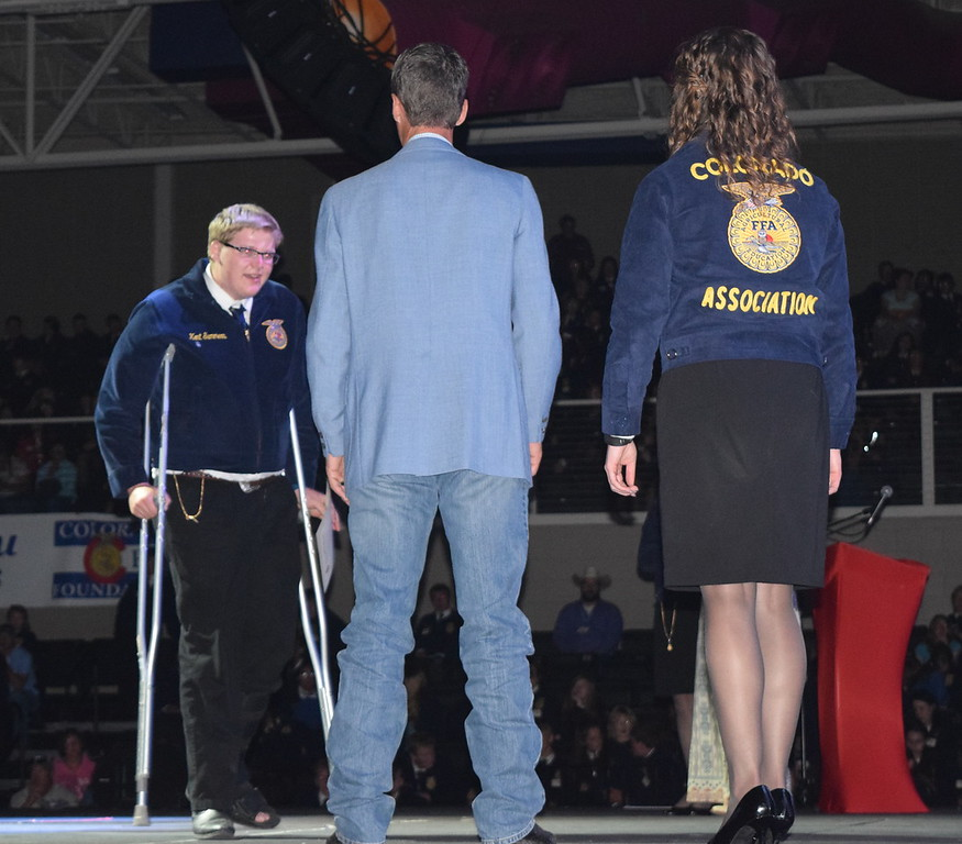 Kent Summers, of the Caliche FFA chapter, makes his way across the stage to greet his adviser Todd Thomas after receiving his State FFA Degree at the Colorado FFA State Convention Wednesday, June 8, 2016.