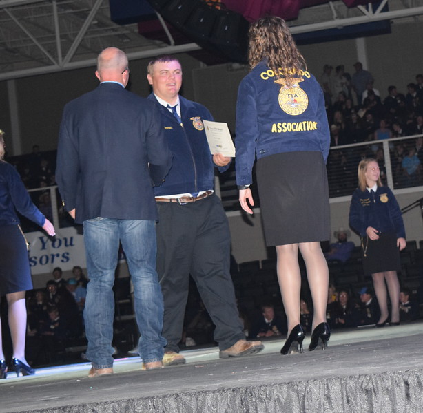 James Ommen, of the Peetz FFA chapter, is congratulated by his adviser Mike Forster after receivng his State FFA Degree at the Colorado FFA State Convention Wednesday, June 8, 2016.