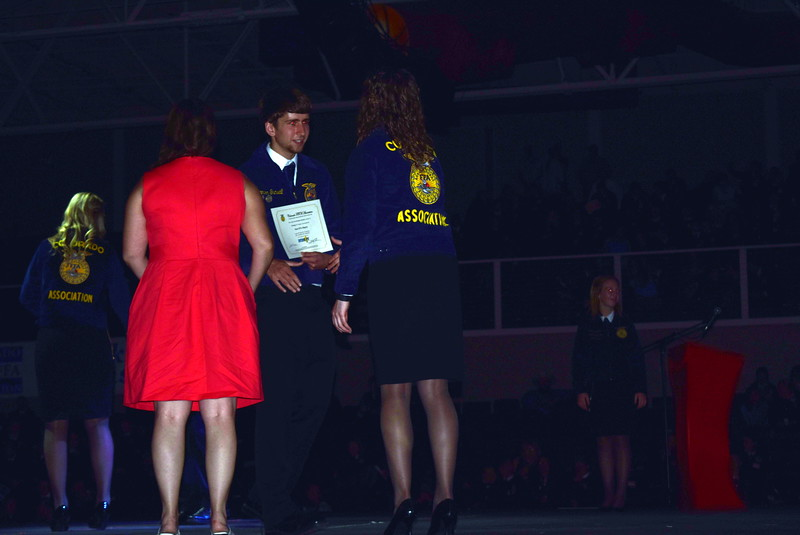 Brenden Gunwall, of the Sterling FFA chapter, makes his way across the stage after receiving his State FFA Degree at the Colorado FFA State Convention Wednesday, June 8, 2016.