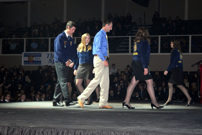 New Raymer's farm business management team makes their way off the stage after being recognized at the Colorado FFA State Convention Wednesday, June 8, 2016.