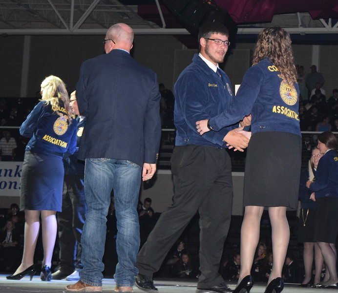 Garrin Cox, of the Peetz FFA chapter, is congratulated by Rachael Latta, FFA state treasurer, after receiving his State FFA Degree at the Colorado FFA State Convention Wednesday, June 8, 2016.