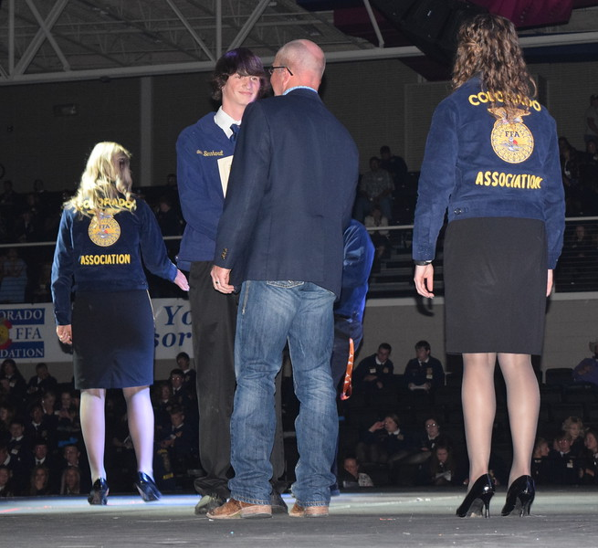 Shawn Bernhardt, of the Peetz FFA chapter, is congratulated by his adviser Mike Forster after receiving his State FFA Degree at the Colorado FFA State Convention Wednesday, June 8, 2016.