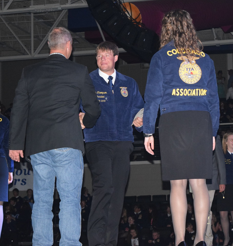 Seth Thompson, of the Haxtun FFA chapter, is congratulated by his adviser Jeff Plumb after receiving his State FFA Degree at the Colorado FFA State Convention Wednesday, June 8, 2016.