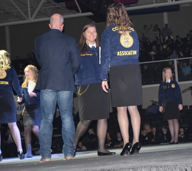 Jodie Schumacher, of the Peetz FFA chapter, is congratulated by her adviser Mike Forster after receiving her State FFA Degree at the Colorado FFA State Convention Wednesday, June 8, 2016.