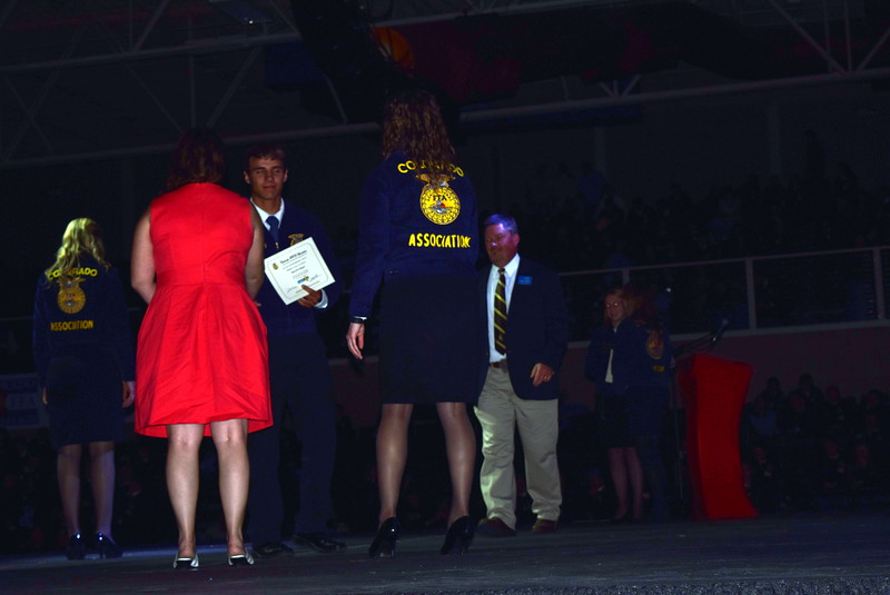 Peyton Kloberdanz, of the Sterling FFA chapter, is congratulated by his adviser Kassandra Kinney after receiving his State FFA Degree at the Colorado FFA State Convention Wednesday, June 8, 2016.