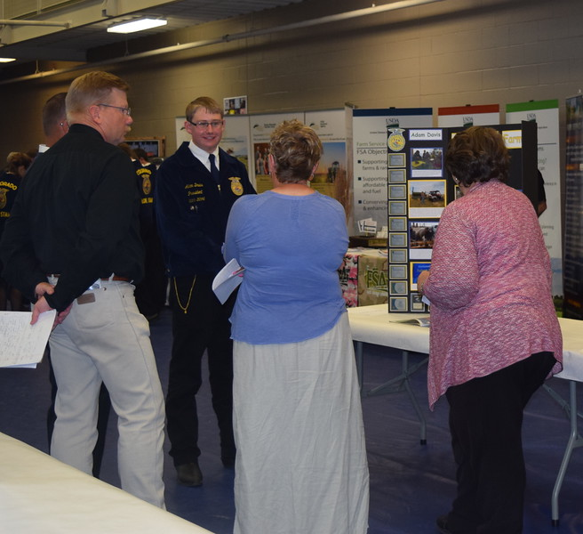 Adam Davis, of the Peetz FFA chapter, talks with visitors looking over his poster board on his Superivised Agricultural Experience (SAE) project during an SAE Career Fair at the Colorado FFA State Convention Wednesday, June 8, 2016. Davis was named a Star Farmer and was also recognized as state proficiency winner in chicken poultry production for his SAE project.