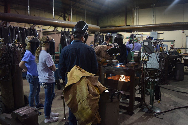 Caliche High School students watch as a student in Northeastern Junior College's welding program demonstrates how to weld during a tour of the program Friday, Oct. 6, 2017,  for the Manufacturing Sector Partnership in Northeast Colorado 's Manufacturing Day event.