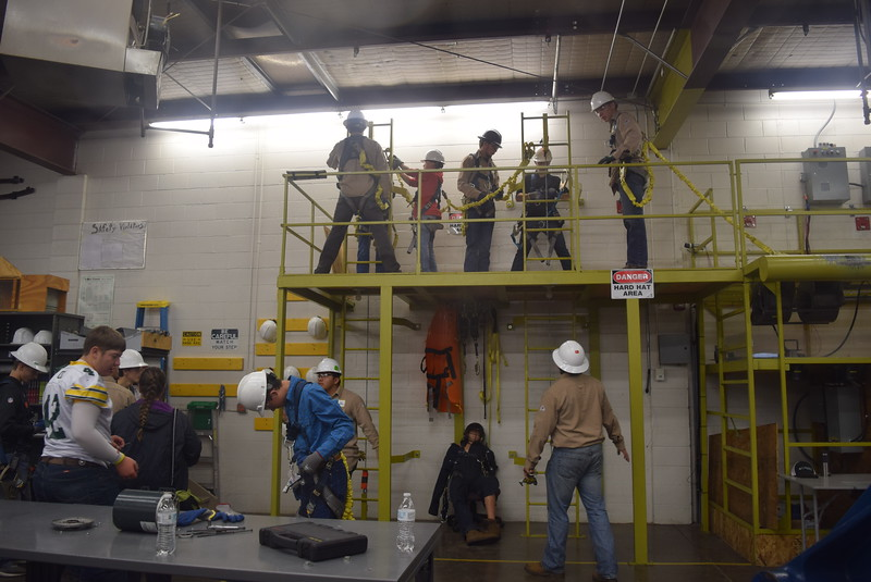 Caliche and Peetz High School students learn how to climb a wind turbine during a tour of Northeastern Junior College's wind technology program Friday, Oct. 6, 2017, for the Manufacturing Sector Partnership in Northeast Colorado's Manufacturing Day event.