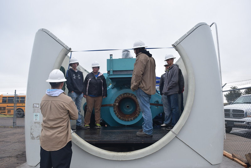 Northeastern Junior College wind tech students talk to Caliche and Peetz High School students as they get an up-close look at the inside of a wind turbine during a tour of the wind tech program Friday, Oct. 6, 2017, for the Manufacturing Sector Partnership in Northeast Colorado's Manufacturing Day event.