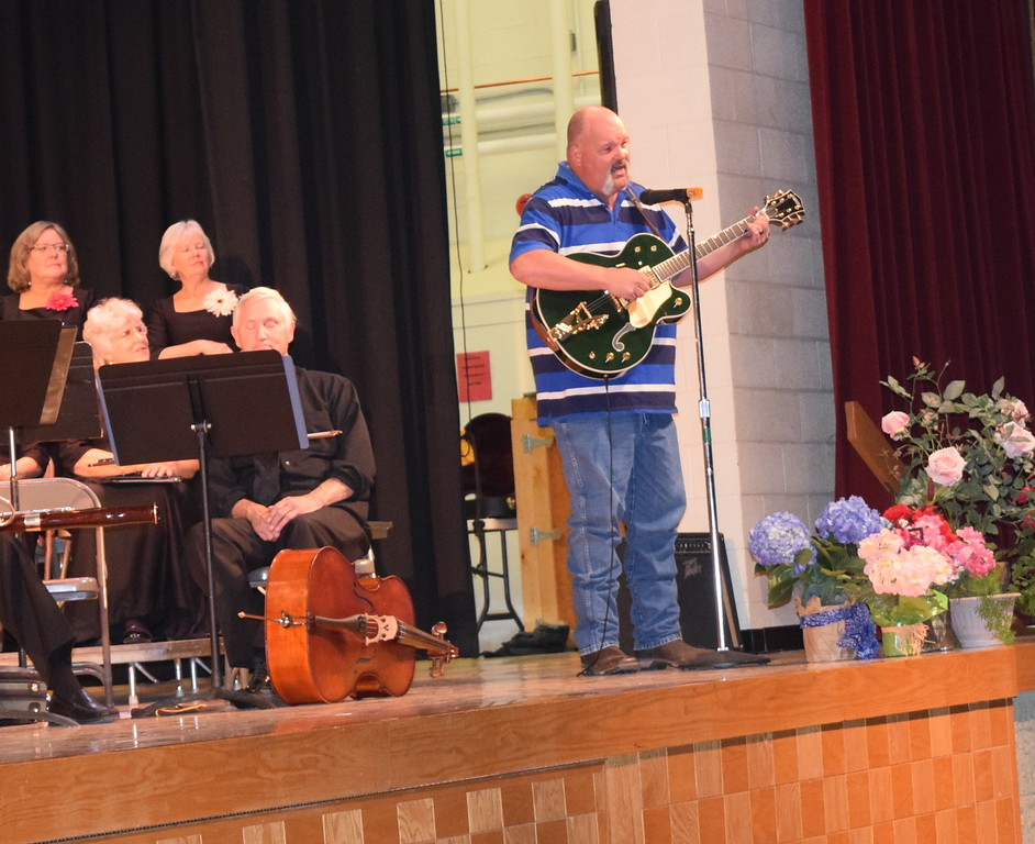 """Jimmie Schneider performs a song he wrote, """"Grandma, You Were There For Me,"""" during Master Chorale's Spring Concert XXV Sunday, May 8, 2016."""