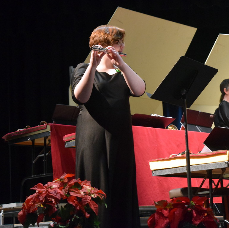 "Camryn Trump plays a flute solo during Master Chorale's performance of ""The Holly and the Ivy"" at their 26th Noel Christmas Concert Sunday, Dec. 10, 2017."