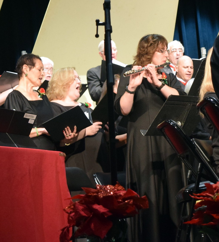 """Tara Edelen plays the flute during Master Chorale's performance of """"Gesu Bambino"""" during the choir's 26th Noel Christmas Concert Sunday, Dec. 10, 2017. She also performed a duet of """"Go, Tell It on the Mountain"""" with Nita Gillham on the piano."""