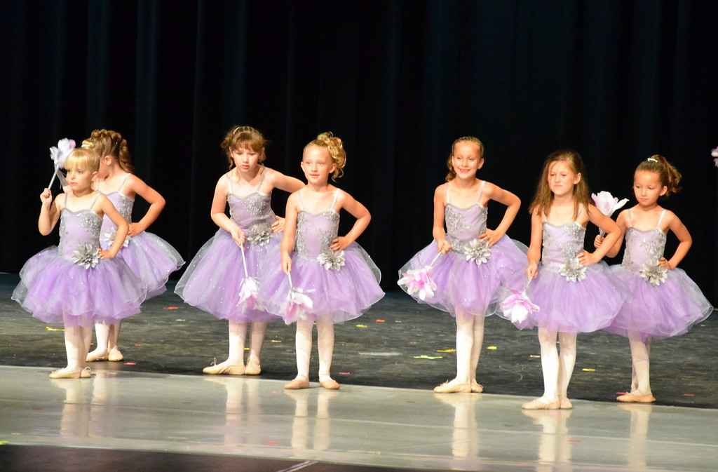 ". Ballerinas dance to ""Cinderella-The Work Song\"" at Melissa\'s School of Dance and Gymnastics\' \""Dance in Motion\"" recital Wedneday. Front row, from left; Brinley Hect, Callie Schoenberg, Morgan Frankenfeld. Back row, from left; MaKenna Eastin, Lilly Johnson, Ashtyn Fuller, Chloee Kloberdanz."