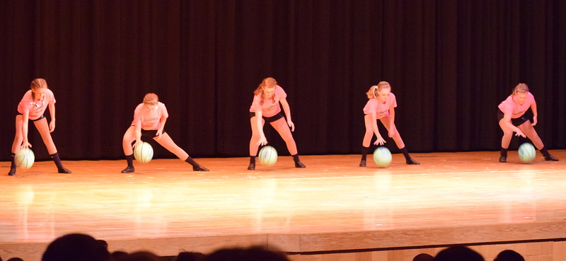 """Molly Mitchell, Charli Frankenfeld, Emi Reeves, Madison Amen and Kayleigh Mackintosh dance to """"Get Your Head in the Game"""" at Melissa's School of Dance and Gymnastics' """"Remember When"""" spring recital Wednesday, June 14, 2017."""