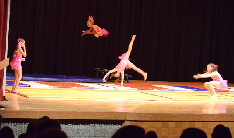 """Gymnasts perform to """"Footloose"""" at Melissa's School of Dance and Gymnastics' """"Remember When"""" spring recital Wednesday, June 14, 2017."""
