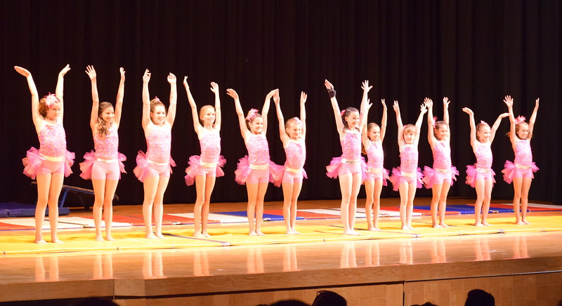 "Ava Reeves, Ciana Lousberg, Lauren Lorenzo, Hailey Foos, Aja Richie, Taylor Tonche, Aeris Evanson, Serenity Dick, Grace Petersen, Abby Pancheco, Connie Gassaway, Ashley Bornhoft and Sara Goodman take a bow after performing to ""Footloose"" at Melissa's School of Dance and Gymnastics' ""Remember When"" spring recital Wednesday, June 14, 2017."
